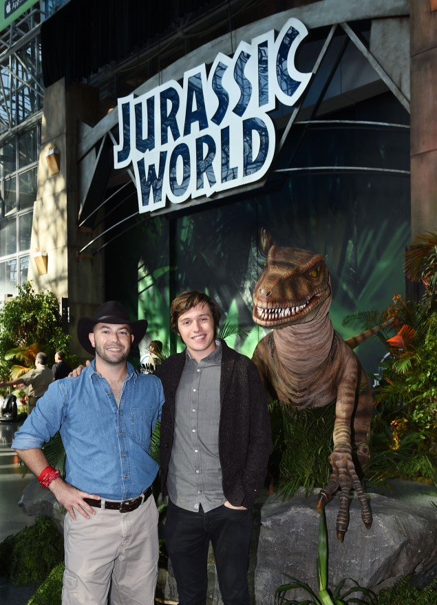 NEW YORK, NY - OCTOBER 10: Universal Orlando Raptor Expert Brian Wynne with film star Nick Robinson and the Raptor at the Jurassic World Gates at New York Comic Con in celebration of the upcoming Blu-ray and DVD release at Jacob Javits Center on October 10, 2015 in New York City. (Photo by Ilya S. Savenok/Getty Images for Universal Pictures Home Entertainment)